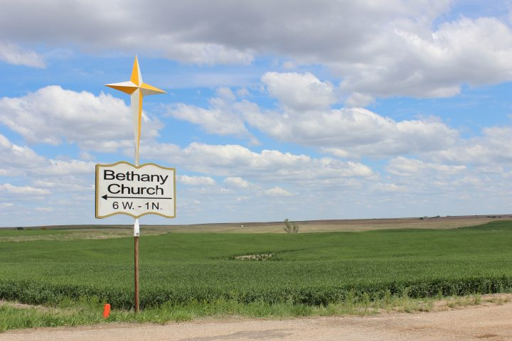 Sign on Highway 14 pointing to Bethany Church in Lincoln County, Kansas
