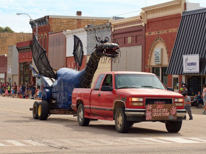 Thresh-0-Saurus, one of the creations along Highway 18 near Lincoln, Kansas, particpating in the annual Post Rock Festival parade in this photo. (photo by Kris Heinze)