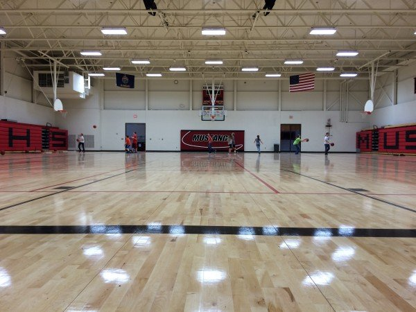 The Sylvan-Lucas High School gym returned to use in November with a newly installed floor after an April storm left the district with nearly three-quarters of a million dollars in damages, including severe damage to the high school gymnasium.