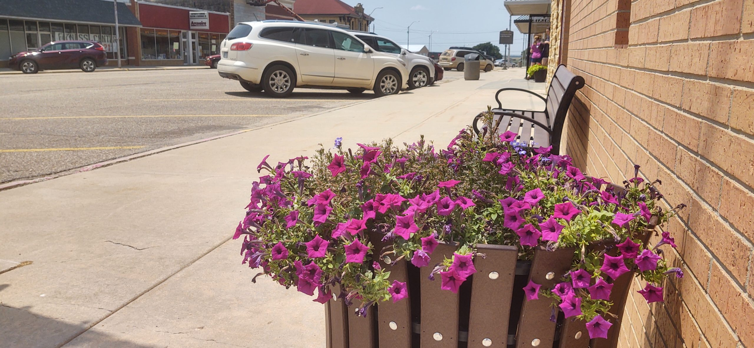 Lincoln PRIDE group flower pots and benches in downtown Lincoln, Kansas