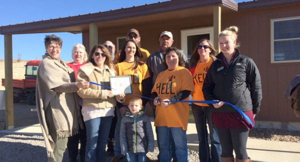 Members of the Lincoln Area Chamber of Commerce celebrated the opening of the new Hell Creek Cabins at Wilson Lake last Tuesday with a ribbon cutting. Members of the Usher family, the owners of the new lodging business, are pictured with chamber offi cials Nancy Walter, Colleen Biggs, Kim Meyer, and Jack and Kathie Crispin. (Photo courtesy Kelly Larson)