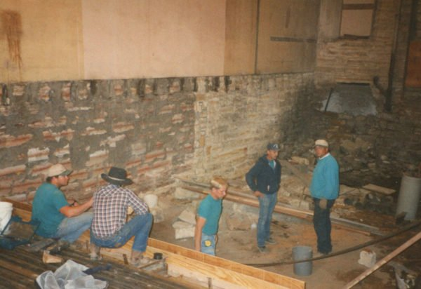 In this photo from October of 1996 Tom Watson, Arturo Campas, Jerry Kruse, Terry Finch and Chris Meyer work on the renovation of the Finch Theatre fl oor. (Photo courtesy Charlene Jones)