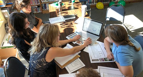 Plans for the Sylvan Grove Public Library's future expansion is starting to get real! The economic development office's summer interns met with library staff and a few board members this morning to review schematic designs.