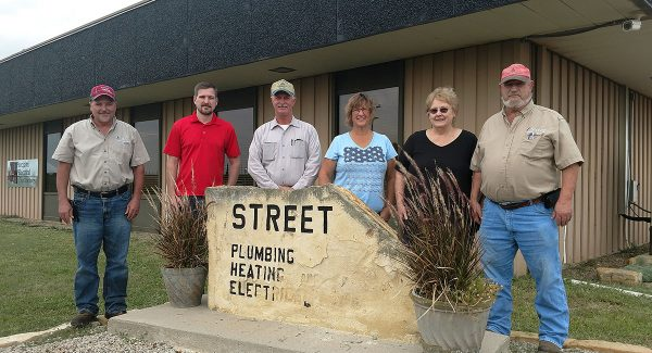 Street Plumbing recently acquired Deep Creek Construction. All of the business owners are pictured together.