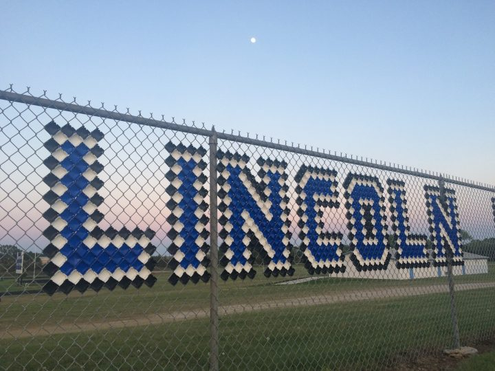 USD 298 Lincoln sign on fence at Mettner Field