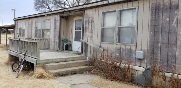 For Sale By Owner - 415 W School Street, Lincoln, KS - 2 bedroom double-wide mobile home with central air on large lot - $12,000